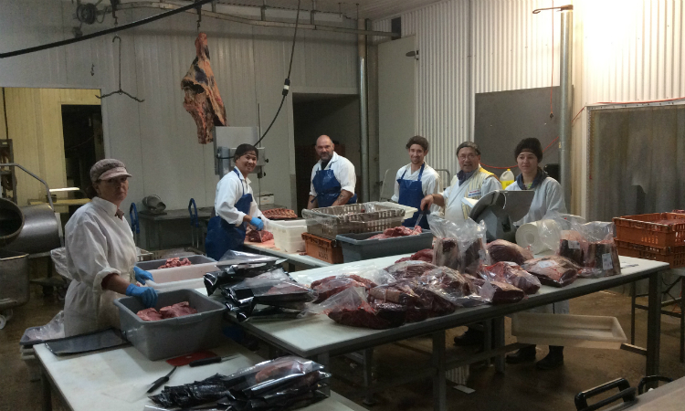 Messinger Family at work in butcher shop